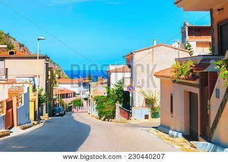 Street In Buggerru City With A View On The Mediterranean Sea, South Sardinia, Italy
