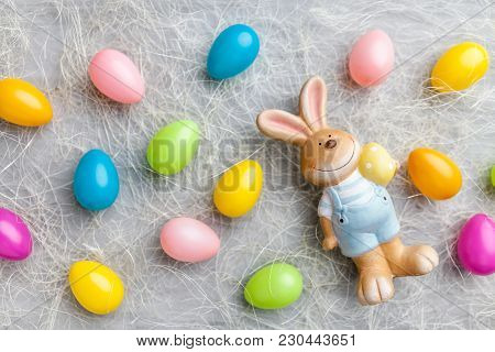 Easter Holiday Bunny On A Rustic Background