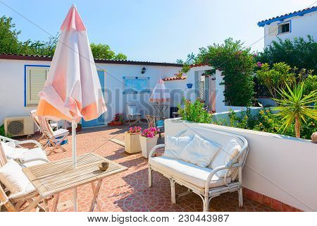 Courtyard Garden With Table And Chairs In The House At Costa Smeralda Resort, Sardinia, Italy