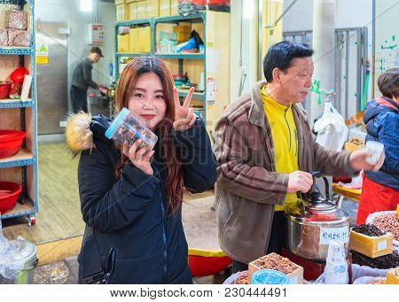 Busan, South Korea - March 12, 2016: Family Selling Nuts In Street Fish Market In Jagalchi In Busan,
