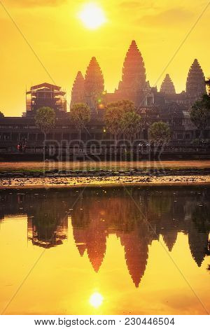 Sunset In Angkor Wat Temple Complex, Siem Reap, Cambodia. The Temple Is Reflected In The Water