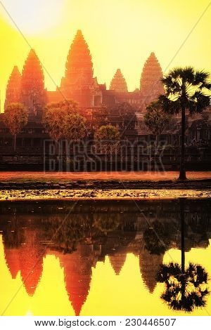 Sunset At Angkor Wat Temple Complex In Siem Reap, Cambodia. The Temple Is Reflected In The Water