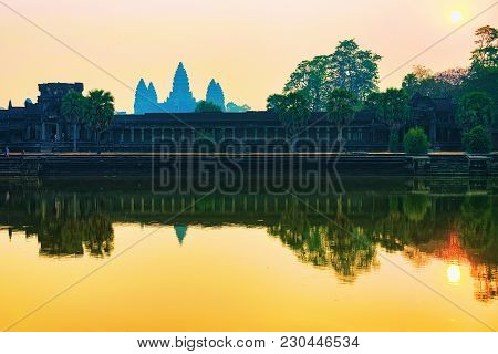 Sunset At Angkor Wat Temple Complex, Siem Reap, Cambodia. The Temple Is Reflected In The Water