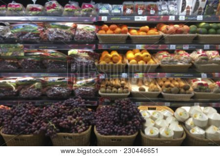 Abstract Blurred Supermarket Aisle With Shopping Mall And Retails Store Interior For Background.