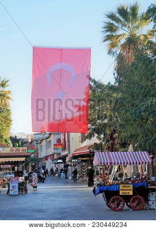 November 2, 2016 - Kusadasi, Turkey: Afternoon In Kusadasi. The Turkish Flag Flies Proudly Above Str