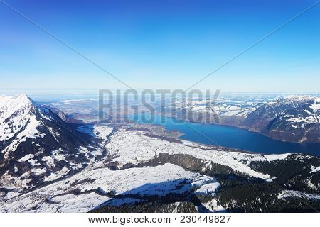 The Center Of Bernese Apline City In Interlaken At Winter Swiss Alps, Helicopter View. Thun Lake On
