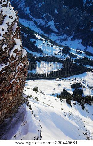 Aerial View To Wengen Village At Bernese Oberland In Switzerland.