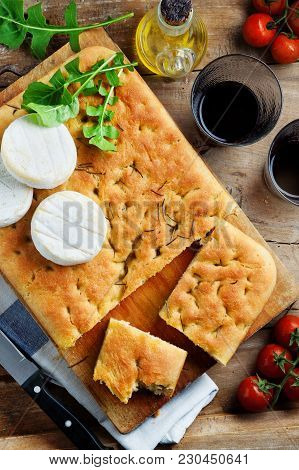 Antipasti, Focaccia And Wine On A Wooden Table. Mediterranean Lunch