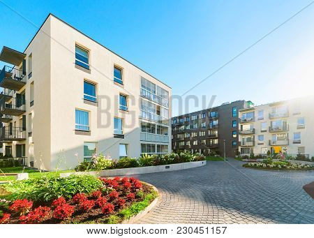 Complex Of Modern Apartment Residential Buildings With Flower Plants And Other Outdoor Facilities. T