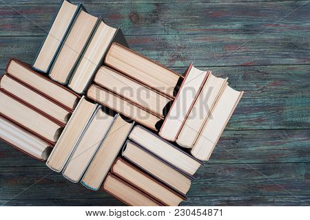 Book Stacking Open Book Hardback Books On Wooden Table. Copy Space