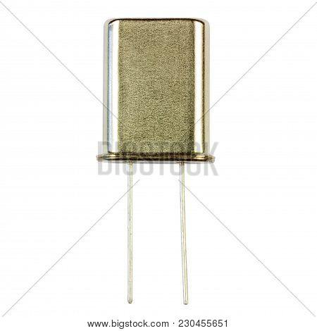 Quartz Resonator Close-up Isolated On White Background. Electronic Component