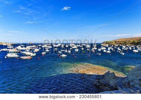 Cadaques, Spain - August 5, 2010: Motorboats In Cadaques Village On The Bay Of The Mediterranean Sea