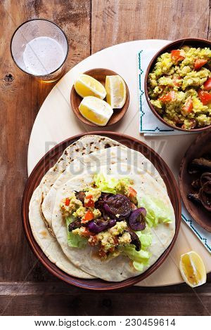 Vegetarian Fajitas With Mushrooms, Onions, Guacamole. And Beer. On A Wooden Table