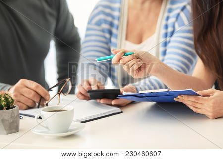 Mature couple discussing pension plan with consultant, closeup