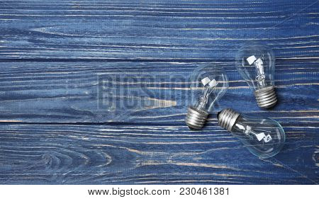 Incandescent lamps on wooden background