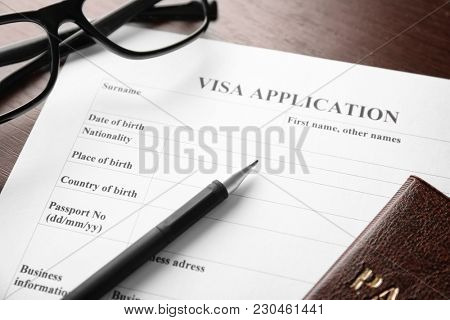 Visa application form on table. Immigration and citizenship