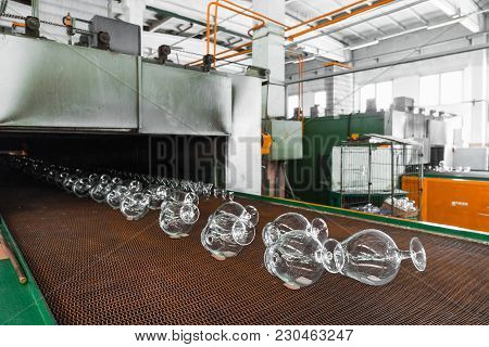 Glass Making Stemware Industry, The Blanks On The Conveyor Leave The Furnace