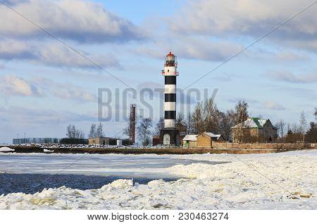 Daugavgriva Lighthouse Located On The Bay Of Riga On The Latvian Coast Of The Baltic Sea.