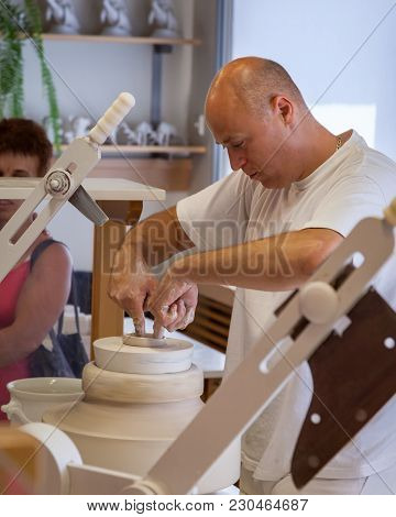 Herend, Veszprem / Hungary - August 03, 2012 - A Herend Porcelain Male Potter Demonstrates How To Ma