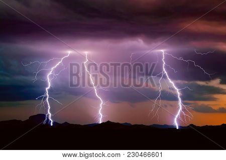 A 2014 Monsoon Lightning Storm Over The Gila Bend Mountains Of Southwestern Arizona Just After Sunse