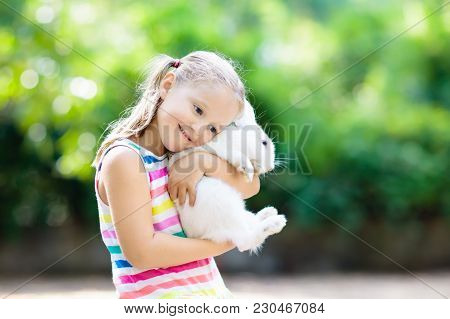Child With Rabbit. Easter Bunny. Kids And Pets.
