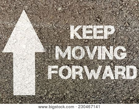 Keep moving forward, writen on road surface