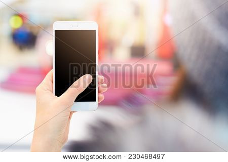Shot Of Unrecognizable Woman Holds Modern Cell Phone With Blank Black Screen Watches Video Or Views