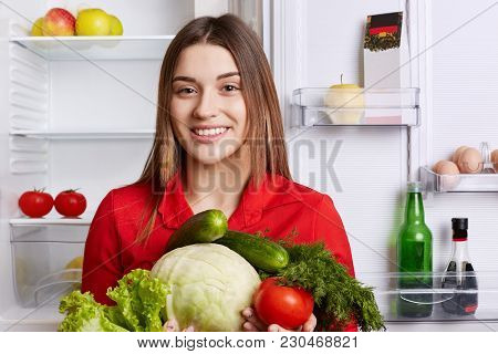 Cute Cheerful Female With Attractive Look Keeps To Diet, Going To Make Vegetable Salad, Keeps Cabbag