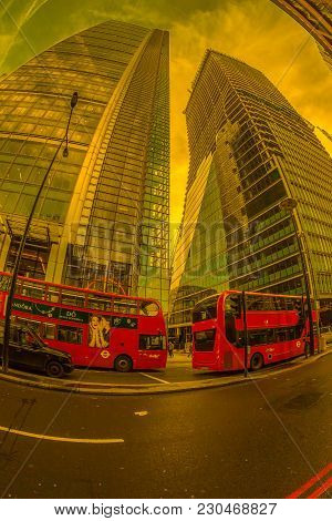 London, England - November 27, 2017: Fish-eye View With Red Double Decker Bus And New Buildings In B