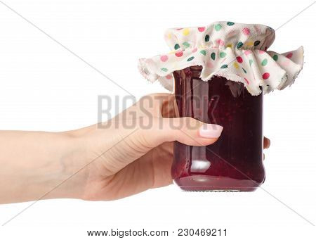 Raspberry Jam In A Jar In Hand On White Background Isolation