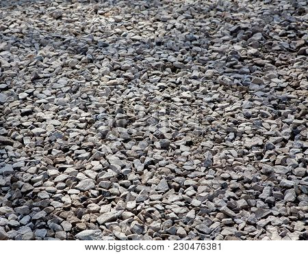 Texture Of Gray Gravel. Grey Stony Floor. A Wall Of Gray Gravel. Stones Small And Medium-sized. Shar