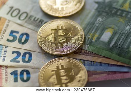 Bitcoin Coins On Euro Background - Stock Image