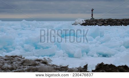 Beautiful Turquoise Blue Ice Flows On The Shore Of Georgian Bay In Meaford, Ontario, Canada. A Marin