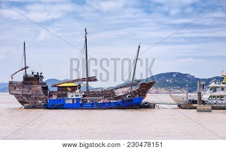A Wooden Replica Ship From Old China Docked At Pier On The Island Of Putushan China On An Overcast D