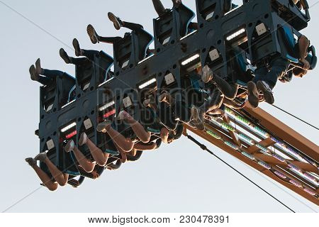Lawrenceville, Ga - September 2017:  The Legs And Feet Of Teenagers Dangle In Midair On A Scary Ride