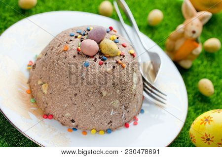 Chocolate Easter Dessert With Colorful Sprinkles And Candy Mini Eggs