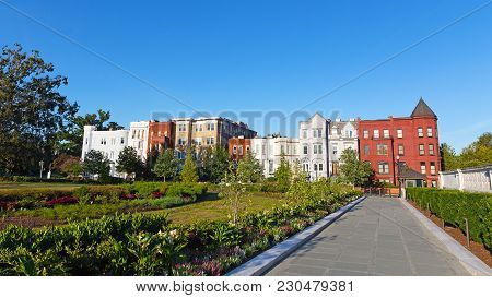 Residential Urban Environment Of Us Capital. Colorful Residential Buildings Surrounded By Garden Pla