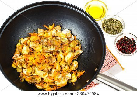 Frying Pan Wok With Fried Champignons, Onions And Carrots. Studio Photo