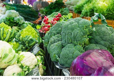 Variety Assortment Of Fresh Ripe Organic Vegetables At Farmers Market. Broccoli Cabbage Radish Lettu