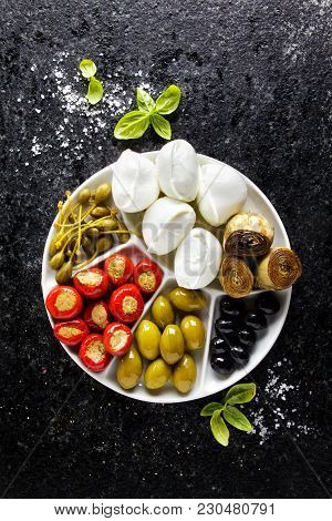 Appetizer Tray Of Green Olives, Black Olives, Capers, Buffalo Mozzarella, Artichokes And Red Chili