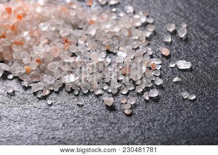 pile of coarse grained salt on black background - detail