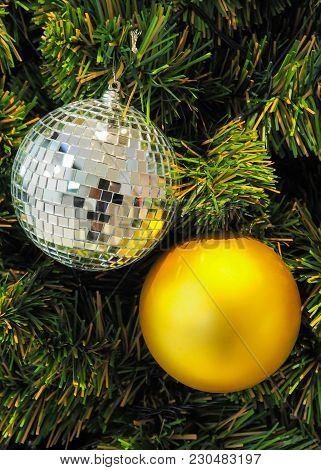 Mirror Balls For Christmas And New Year Day Decorate On Green Grass.