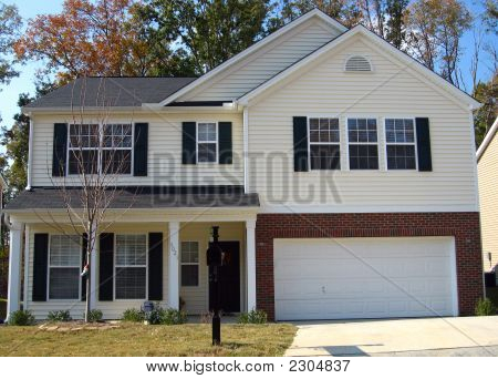 Cute starter home in a suburban subdivision poster