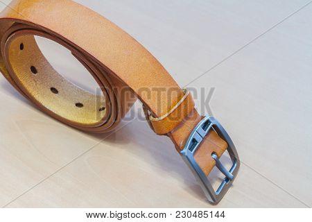 Belts. Belts On A Wooden Background, Fashion Object.