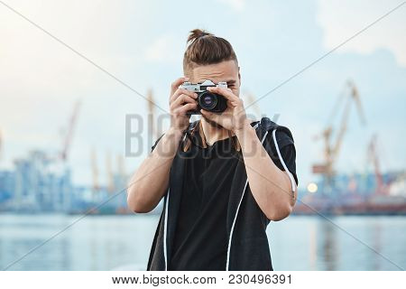 Hunting For Best Shots. Portrait Of Attractive Urban Photographer With Vintage Camera Taking Photos