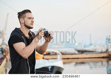 Dreamy Talented Cameraman Impressed With Beauty Of Nature While Taking Photos On Camera, Looking At