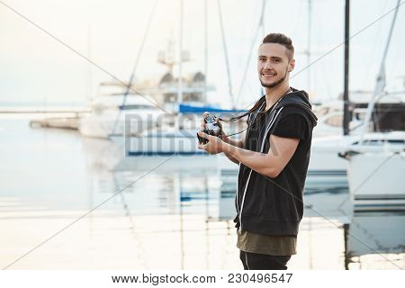 Attractive Boyfriend Focused On His Hobby During Walk With Girlfriend. Portrait Of Handsome Guy Stan