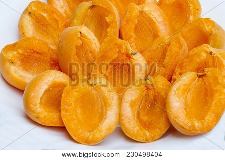 Peeled Apricot On A Plate. Peeled Fresh Apricot On A White Plate Without Pits. Healthy And Natural F