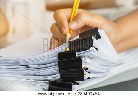 Businessman Hands Searching And Checking Write Unfinished Documents Stacks Of Paper Files On Office