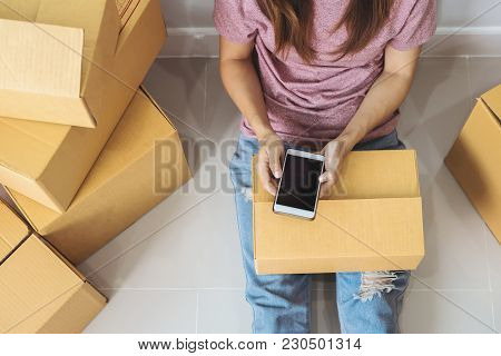 Young Asian Woman Working Online Business By Using Smart Phone, Online Business Owner Concept
